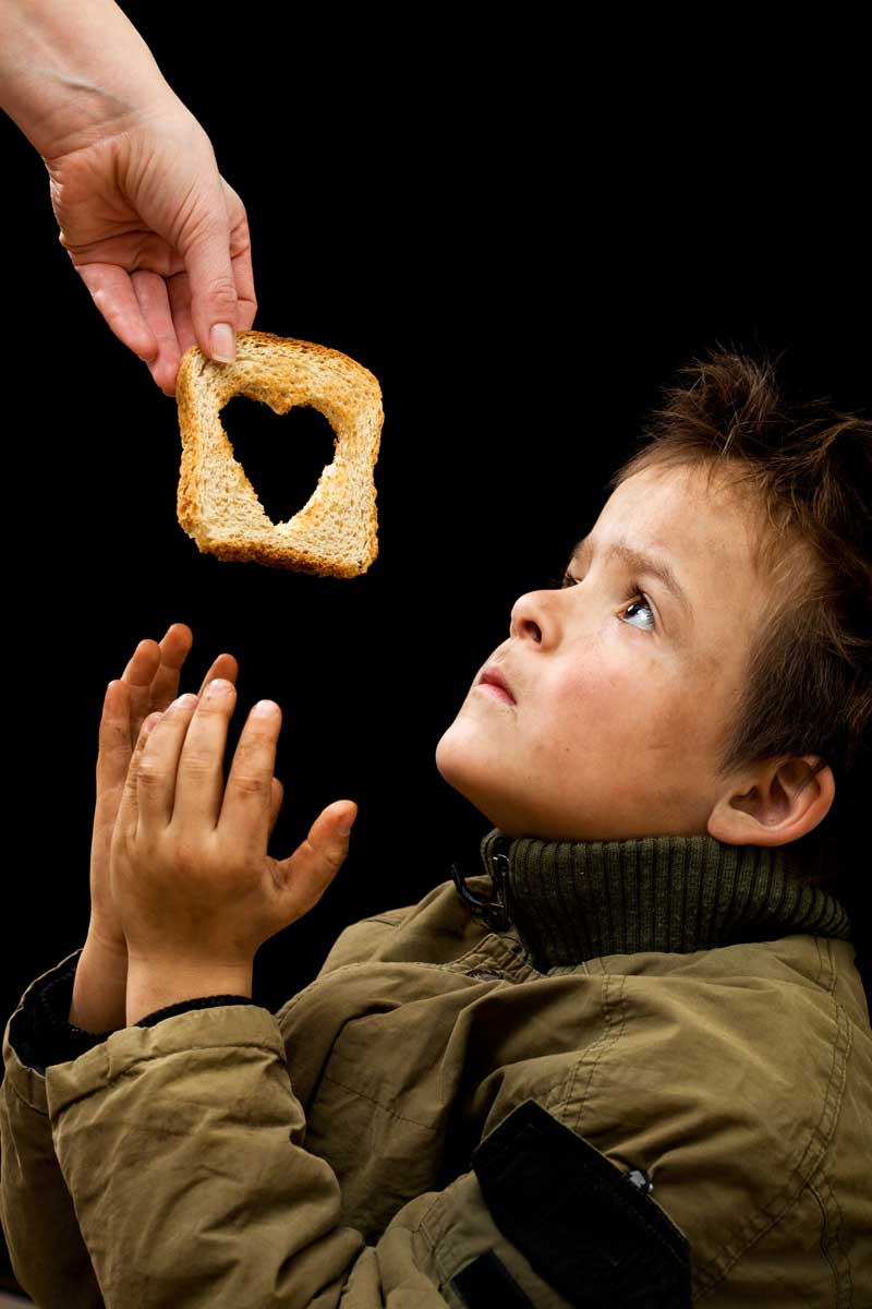 Impoverished Child with bread